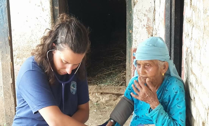 Volunteer of VIN checking health status of Women for diabetes and hypertension