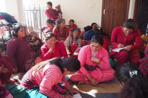 Women discussing about pollution in their Community