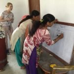 Volunteers teaching essential life skills to women of Kavresthali