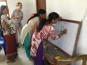 Volunteers teaching essential life skills to women of Kavresthali