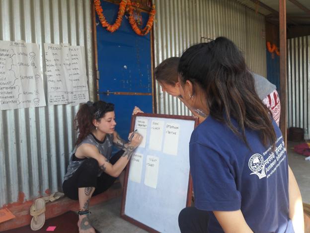 Volunteer writing on the board