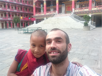 jeremie Gicquel enjoying with children at buddhist monastery