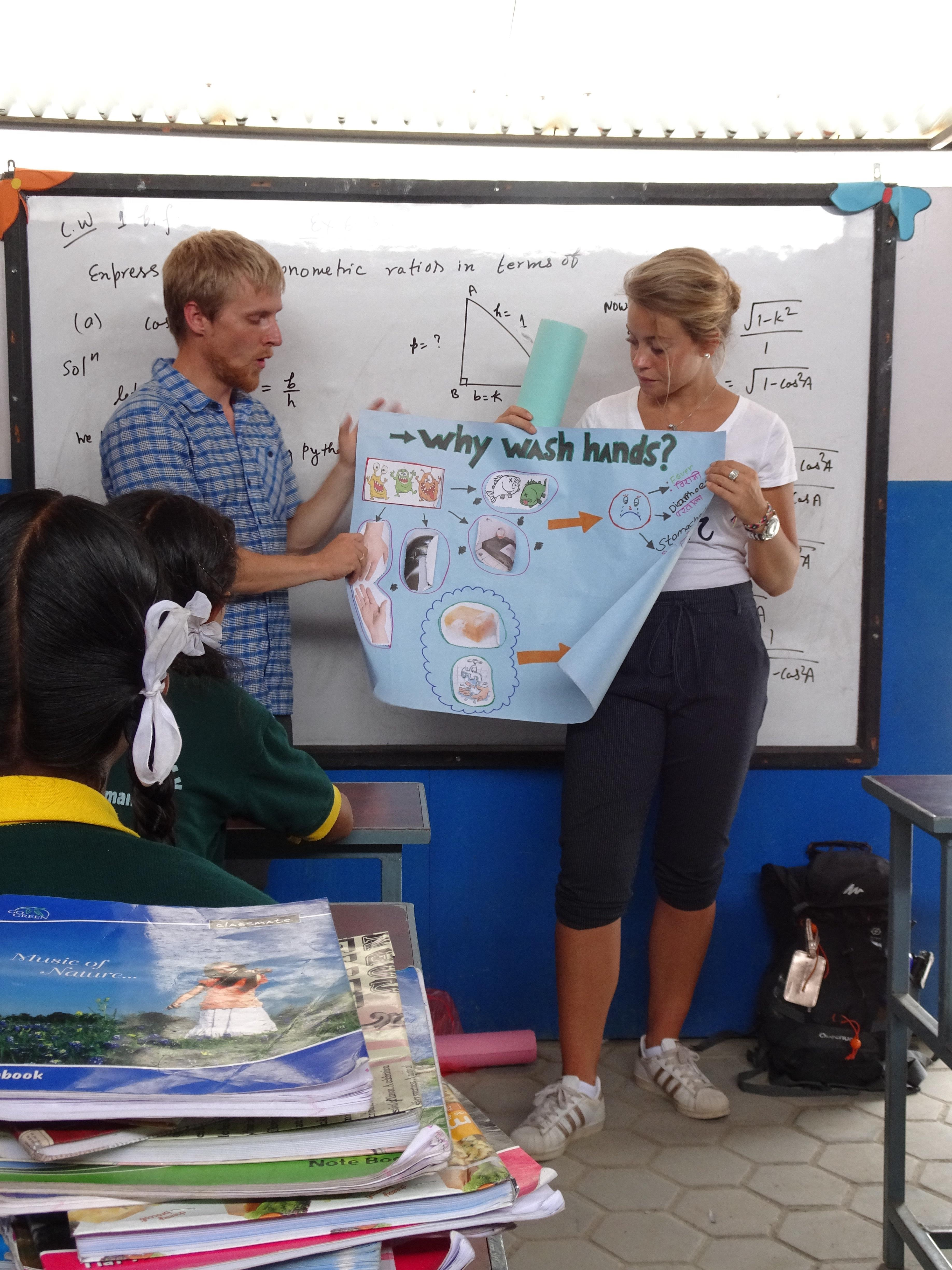 Sherilyn and Melany teaching children about health and hygiene