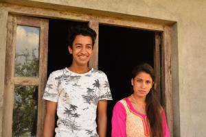 Manita and Sujan in front of their new home in Jitpur